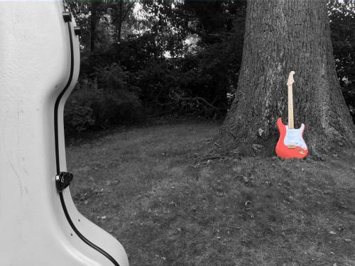 Red Stratocaster and Guitar Case